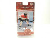 McFarlane Toys NHL Sports Picks Team Canada 2010 Series 2 Action Figure Joe Thornton (San Jose Sharks) White Jersey