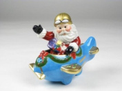 Holiday Santa Claus Riding Blue Plane Salt and Pepper Collectible