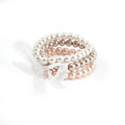 Three Piece Faux Pearl Stretch Bracelet Set Tied with An Organza Ribbon in Natural, Pale Peach and Pale Taupe