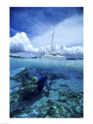 PVT/Superstock SAL1129705 Scuba diver in the water with a sail boat in the background British Virgin Islands -18 x 24- Poster Print
