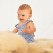 Lambskin babycare rug - unshorn - wool is left natural length.