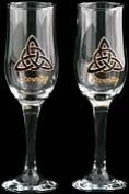 Pair of Champagne Flutes in a Celtic Eternity Knot Design with the word Eternity painted in gold beneath the knot. Handpainted and designed in the UK by Beverley Gallagher, these significant and expressive gifts are ideal for Christmas, Valentine's Day ..