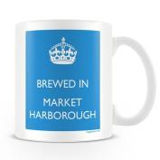 White Ceramic Mug with 'Brewed In Market harborough' Logo.