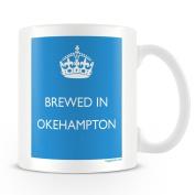 White Ceramic Mug with 'Brewed In Okehampton' Logo.