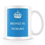 White Ceramic Mug with 'Brewed In Woburn' Logo.