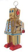 Collectors gold colour tin clockwork walking robot with sparking eyes and mouth