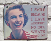 I smile because i have no idea whats going on sign