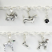 Dog Charm Bracelet. Silver-plated T-bar bracelet with 6 coloured, enamelled charms including a Dalmatian, Scottie and Bone