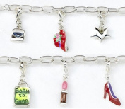 Born To Shop Charm Bracelet. Silver-plated T-bar bracelet with 6 coloured, enamelled charms including a shopping bag, purse and hat