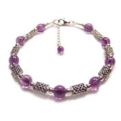 Amethyst purple gemstones and Celtic knotwork Sterling silver bracelet