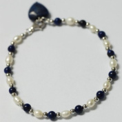 A lapis lazuli, pearl and sterling silver bracelet, delicate lapis lazuli and sterling silver beads with fine oval-shaped pearls, freshwater cultured, white, bracelet length 19cm with 2.5cm extension chain and lobster clasp, genuine sterling silver, ma ..