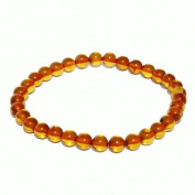 Elegant Baltic Honey Amber Bracelet. One elastic strings expand to fit all wrists. Comes with lovely gift box.