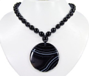 * Amazing necklace made of Sardonyx with a stunning pendant , coloured black and slightly white * Very excellent gemstones * Top * Lovely handcrafted chain from semiprecious stones * Charming * New *