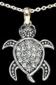 From the Heart Clear Crystal Rhinestone Turtle Necklace with Black Crystal Eyes is adorable!!!Turtle Pendant is attached to 46cm Silver Metal Chain......Fun Sweet Gift for anyone who likes Turtles! Will Mail in Gift Box ! Perfect Gift for the Zoolog ..