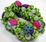 The Original Solaractive® UV Colour Changing Scrunchy! Green with Lady Bugs!