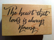 """Phrase Rubber Stamp """"The Heart That Loves Is Always Young."""""""