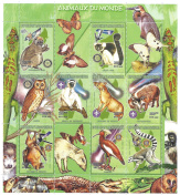 Animals of the world large collectable nature and wildlife stamp sheet featuring birds, mammals, reptiles and insects / 12 stamps / Madagascar
