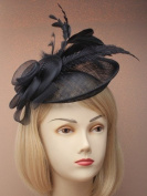 Large black Hatinator hessian base fascinator hat on band with swirl lush and shaped feathers