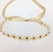 Gold Metalic Flower Wrap with Red. Rhinestones