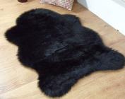 Black faux fur sheepskin style rug 70 x 100 cm washable