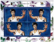 Bruce Lee in with hand raised fight pose - Mint and never mounted stamp sheet