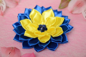 Handmade blue and yellow puffy hair clip with a flower of satin ribbons