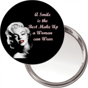 """Button, Compact Makeup Mirror with Marilyn Monroe image """"A smile is the best make up a woman can wear"""" delivered in a black organza bag."""