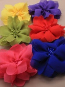 Bright coloured chiffon fabric flower on a forked clip
