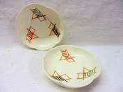 Pair of deck chair petal dishes.