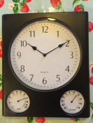 Clock with temperature and humidity dials