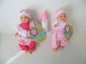 Baby Dolls 2 Mini Toysmith Baby Dolls Caucasian Plus Disappearing Milk Baby Doll Bottle Ages 3yrs +
