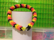 6 Pin Hexafish Fishtail Rainbow Loom Rubber Band Bracelet in Black. Yellow, Orange and Red