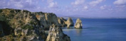 Panoramic Images PPI42484L Rock formations on the beach Lagos Algarve Portugal Poster Print by Panoramic Images - 36 x 12