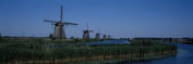 Panoramic Images PPI109023L Traditional windmills at a riverbank Kinderdijk Rotterdam Netherlands Poster Print by Panoramic Images - 36 x 12