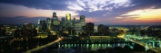 Panoramic Images PPI92436L Buildings Lit Up At Dusk Minneapolis Minnesota USA Poster Print by Panoramic Images - 36 x 12