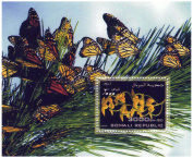 Collectable stamp sheet with butterflies and yellow orchids - 1 stamp on sheet issued 2006 / Somalia / MNH