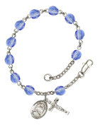 Silver Plate Rosary Bracelet features 6mm Sapphire Fire Polished beads. The Crucifix measures 5/8 x 1/4. The charm features a St. Kateri Tekakwitha medal.