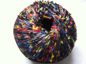 Muench Oceana Yarn #4812 Midnight Multi with Red, Yellow, Blue, Black Bows - 50 Gramme
