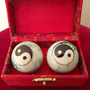 Chinese Health Balls with Chimes and Yin Yang (Balance) Symbol. Health balls stimulate acupressure points. Balls come in a traditional chinese presentation box.