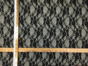 150cm w Polyester black lace fully infused to fabric. Fabric by the yard
