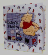 Baby's First Photo Album Featuring Disney's Winnie the Pooh by A.D. Sutton & Sons, Inc.