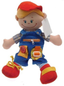 Rag doll boy design with rattle in one foot