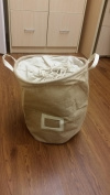 Laundry Storage Basket with drawstring to close top, beige non woven fabric, wont mould or smell, with name tag in front, laundry sorter, toy storage