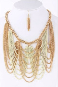 Bunched gold/off-white chains hangs mid level