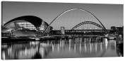 Canvas Picture Tyne Bridges at Night in Black and White - Panorama stretched and mounted around a 38 x 18 inch (96cm x 46cm) wooden frame by Pixel Zone