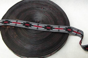 AM017- 1.9cm X 50Y, GREY WITH BLACK, RED AND WHITE AZTEC DESIGN RIBBON