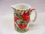 Poinsettia christmas design cream jug made for the Abbeydale collection for Heron Cross Pottery.