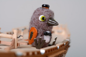 Homemade felted miniature toy Crow