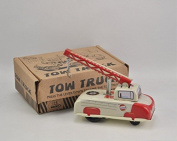 Vintage tin spring loaded wind up Tow truck