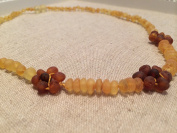 38cm Lemon Flower Baltic Amber Necklace for adult, big kid, teenager will all benefit. Growing pains, arthritis, carpal tunnel, cramps, fever, headache, back ache, hypothyroid, certified.